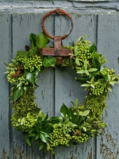 (via For The Home And Garden / Moss, ivy, and eucalyptus wreath.)