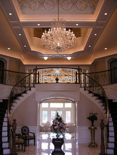 Love the regal feeling of the dual curved staircases!