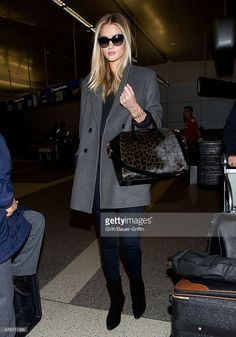 Rosie Huntington-Whiteley is seen at LAX on February 28, 2014 in Los Angeles, California.