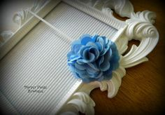 Simple, blue flower headband. Great price and low shipping!