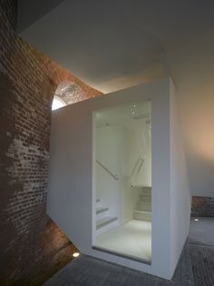 Another view of the staircase inside a renovated watertower by Rocha Tombal architects. I always like the clash between the materiality of old brickwork and the abstract lack of it in plaster.