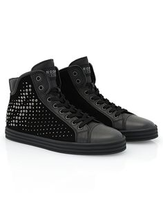 #HOGANREBEL R182 High-top #sneaker in #suede with leather and patent leather details, visible stitching and side machining characterized with metal #studs  effect. With small wedge invisible inside. A shoe of #rock #spirit. Discover more here hoganrebel.com/women