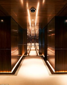 The interior of the luxury yacht features wood paneling to continue the feeling of affluence throughout the vessel