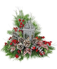 A charming tea light lantern is the focal point of this beautiful, wintry arrangement. Fresh evergreens, glittered twigs, faux berries, Christmas balls, frosted pine cones and silver and red ribbon complete the look of this three sided arrangement. It would also be suitable to remain on display after the holidays have passed. It's available with fresh or silk evergreens, and also in red or blue.