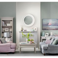 Be inspired by soft pastel shades to create a harmonious living room. This mix of watery tones gives the scheme a calming look without overloading the room. An underlined fireplace becomes the focal point with painted green alcoves either side Pastel Living Room, Grey Walls Living Room, Fresh Living Room, Living Room Decor Colors, Living Room Modern, Home Living Room, Bedroom Decor, Living Area, Interior Pastel