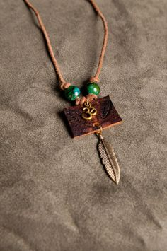 Join Woodland Caravan at TCH's Vintage Jewelry Sale and Tea February 15th 2014  Om and Feather Talisman Pendant. Made from by WoodlandCaravan, $17.00