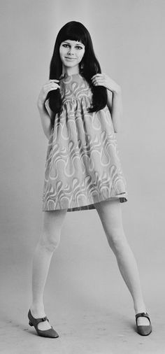 Dian Poore wearing a baby doll cotton mini dress by Biba 1967