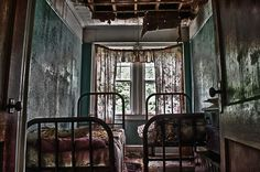 twin beds amid the decay