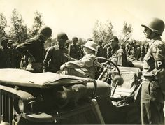 US Secretary of War Henry L. Stimson greeting a Japanese-American US Army captain of 442nd Regimental Combat Team, Route 68, north of Cecina, Italy, 6 Jul 1944 (Source: US Army Signal Corps)