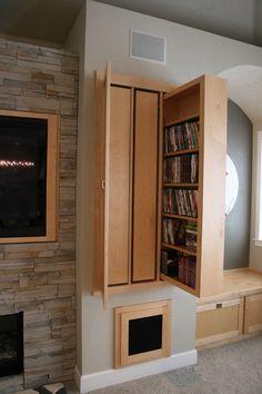 Pull-out media storage, behind doors