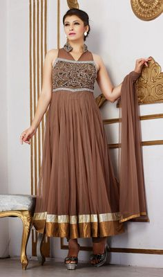 Brown Embroidered Net Long Length Anarkali Dress Reveal the exuberance in you draping on this brown embroidered net long length Anarkali dress. This attire is nicely designed with crystal, lace and stones work. #LongLengthAnarkaliDress #LatestDesignerAnarkaliSuits
