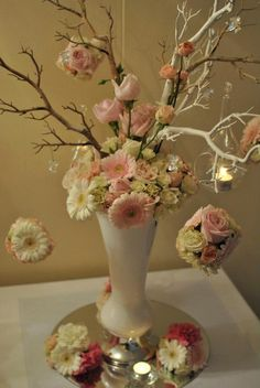 Tree branches with floral arrangement by Agnie's Floral Designs, hanging glass tea light holder and crystals