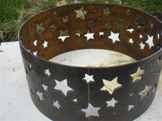 Stars fire pit ring This piece has beautiful star of different sizes all around. It is made from 1/4in recycled steel. This fire pit ring will last your family generations of maintenace free fires. The glow of the fire shines throught the stars to make beautiful stars on the ground and surrounding areas. : H 14 W 30 $325.00