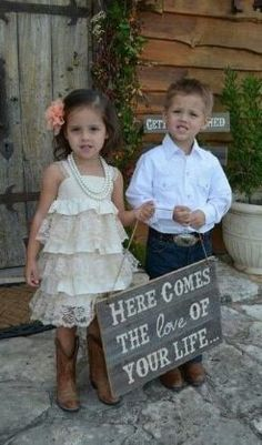 we could have Breanna and Matthew Carry this sign down and you follow them with Dad....ADORABLE!!!!!: