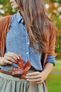 Gingham checkered blouse, burnt orange cardigan, olive skirt