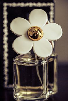 I love daisies and beautiful perfume bottles!
