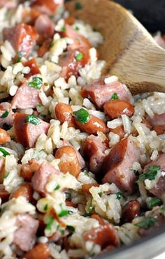 INGREDIENTS 1 tablespoon extra virgin olive oil 1 tablespoon unsalted butter 1 package (14 ounce) polska kielbasa, diced 1 medium sweet onion, diced 1 cup white rice 2 cups low sodium chicken broth 1 can (14 ounce) pinto beans, rinsed and drained 1/2
