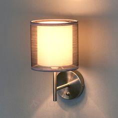Czarująca materiałowa lampa ścienna Nica, szara