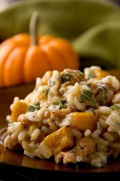 "Pumpkin Risotto, And The Legacy Of ""The Littlest Pumpkin"" Roasted Pumpkin Risotto.risotto is believed to have originated in northern Italy in the century.risotto is believed to have originated in northern Italy in the century. Vegetarian Recipes, Cooking Recipes, Healthy Recipes, Rice Recipes, Healthy Food, Thanksgiving Recipes, Fall Recipes, Fall Dinner Recipes, Pumpkin Risotto"