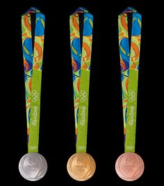#RIO2016 In this handout provided by Jogos Rio 2016 the front of the gold silver and bronze medals for the 2016 Summer Olympics is shown June 8 2016 in Rio de...