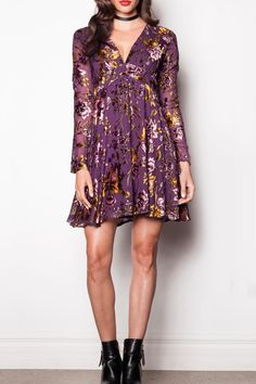 This dress is sure to turn heads and put you in the center of attention. The Flower Of The Flock Dress has long sleeves, a V-neck and a flare bottom starting high on the waist. It also features the most luxurious floral print for winter of purple and gold shades. This beauty can be paired with strappy heels or worn with your favourite boot.   Rich Floral Flare by Pink Martini. Clothing - Dresses - Long Sleeve Clothing - Dresses - Floral Clothing - Dresses - Mini Canada