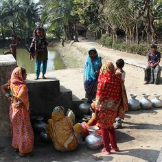 Women and children line up to fill their water vases at this community pond sand filter in Bangladesh. #CleanWaterWednesday