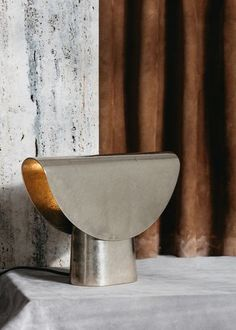Henry Wilson debuts his Cast Impressions collection in Milan : 'Fold' light, cast in high tensile brass. This is Wilson's slimmest casting to date.