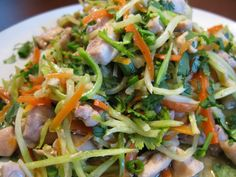 """Paleo Chicken Pad Thai 1½ lb chicken meat, cut into small 1"""" chunks 4-5 Tbsp extra virgin coconut oil  5 cloves garlic, finely chopped 3 Tbsp Fish Sauce 1 Tbsp Coconut Aminos  4 Tbsp fresh lime juice ½ Tbsp Coconut Vinegar  5 Tbsp chopped fresh cilantro 4-5 green onions, finely chopped 1 12oz package of broccoli slaw 2 medium carrots, cut into thin julienne strips"""