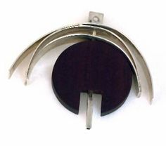Pendant | Betty Cooke.  Sterling silver and wood.