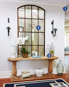 """""""Treat it as its own room, not just a pass-through space. Add a rug, a chair or bench, a table with books, a candle, a plant, to make guests — and you — feel at home as soon as they walk in. These ideas will work even in a teeny-tiny little entryway."""" —Libby Langdon"""