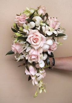 Cascade wedding bouquet with pale pink roses and white dendrobium orchids. floral@kuhlmanns.com