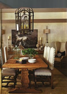 A farm table and iron details lend Old World sensibilities to this neutral dining room - Traditional Home® / Photo: Eric Roth / Design: Joseph Abboud in partner with RH Farmhouse Dining Room Table, Dining Room Chairs, Dining Room Furniture, Dining Table, Rustic Table, Wood Table, Rustic Wood, Salvaged Wood, Fine Dining