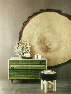 Rug in the shape of a tree stump...can also pose as wall art. Love it.
