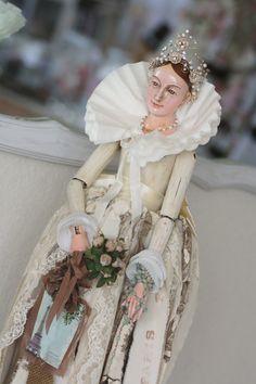 Beautifully dressed santos doll