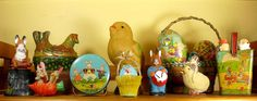 Old Peter Rabbit Easter tin, paper mache rabbit candy container, tin cackling hen that lays eggs, and more.  My favorite is the spun cotton bunny riding the chick.  So cute!