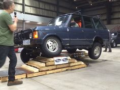 Range Rover Classic on articulation ramps @ Rover Landers Founders Day show 2015