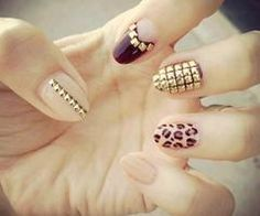 Studded nails, leopard print, pastel colored. Wild nail design