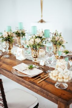 elegant wedding centerpiece using candle to highlight wedding color; photo: Cojo Photo