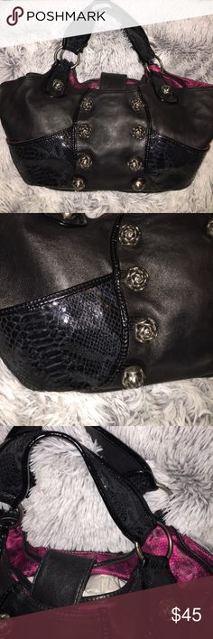 SALE!!!🖤Betsey shoulder bag🖤 AMAZING Betsey Johnson Black Leather shoulder bag! PVC trim. Has gorgeous snake skin like detail on the sides and straps. I can't even say enough about how beautiful this BJ bag is! Has pewter rose bud hardware. TONS of space inside! The sides where the snake skin is, is also a pocket/pouch! Inside is completely clean and is a floral lace design. Small Horse shoe charm on zipper pocket inside. Handles show no wear, neither does the bottom. Used few times and…