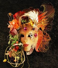 handmade Venetian mask depicting summer ,this is part of the four seasons mask collection.
