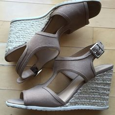 Franco Sarto nude wedges Nude Franco Sarto wedges with natural woven wedge, white sole and silver buckle. Excellent used condition. Worn about 5 times. Franco Sarto Shoes Wedges
