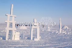 Igloos and Inukshuks built from snow as part of the celebrations for Hamlet Day in Igloolik. Nunavut, Canada.: Canadian Eastern Arctic,: Arctic & Antarctic photographs, pictures & images from Bryan & Cherry Alexander Photography.