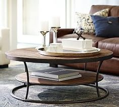 reclaimed wood and iron coffee table - round.  End Tables & Sofa Tables | Pottery Barn