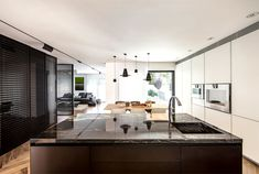B House – Modern Dwelling with Dark Accents