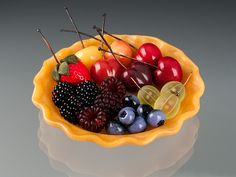 My first pate-de-verre (glass) tart crust, filled with glass berries.