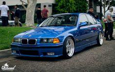 Estoril blue BMW e36 sedan on cult classic OZ Mito II wheels