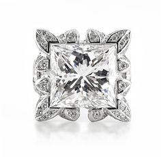 An Important Diamond Ring   Set with a square-cut diamond, weighing approximately 16.62 carats, within a pavé-set diamond floral motif surround and gallery, mounted in 18K white gold.   With report no.12549647 dated 10 April 2003 from the Gemological Institute of America, stating that the diamond weighing 16.62 carats is H color, VS2 clarity  Estimate $450,000 - 650,000