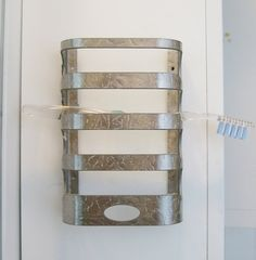 just purchased this on etsy ($15)!  how much does this make sense???  a wall mounted tooth brush caddy!!!