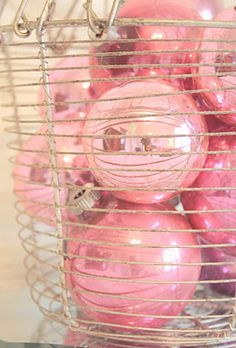 Love the pastel Christmas ornaments in a wire basket