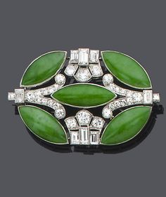 An art deco jade and diamond brooch, circa 1930 The oval pierced plaque of geometric design set with old brilliant, single and baguette-cut diamonds and marquise-shaped jade cabochons, diamonds approx. Jade Jewelry, Art Deco Jewelry, Jewelry Design, Diamond Brooch, Art Deco Diamond, Diamond Pendant, Art Deco Period, Art Deco Era, Diamante Art Deco